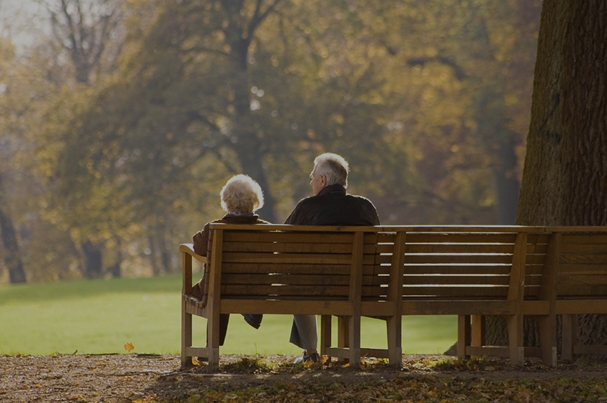 Retired Couple with Secure Estate enjoying a park