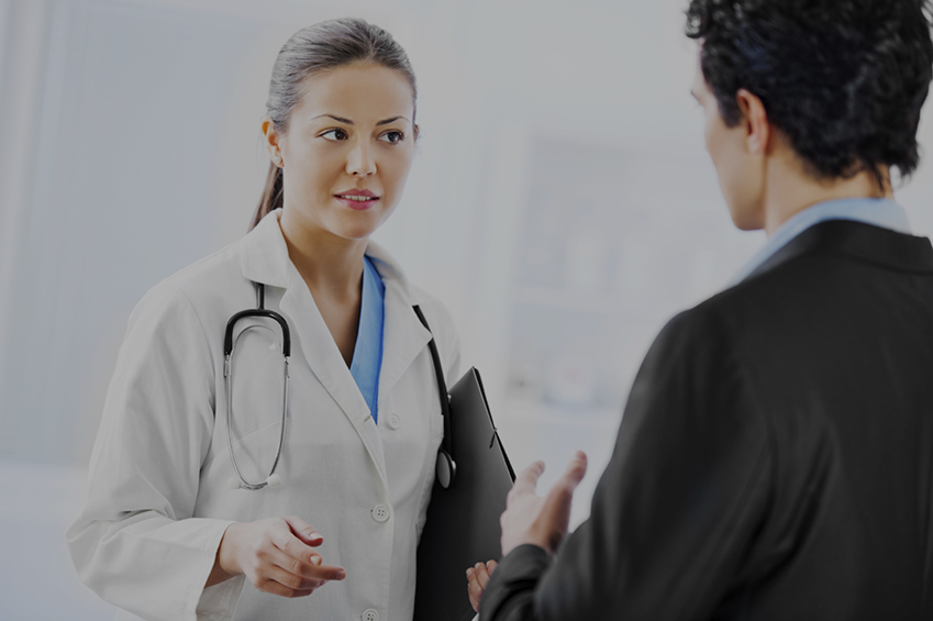 Business man and doctor communicating in the hospital. [url=http://www.istockphoto.com/search/lightbox/9786662][img]http://dl.dropbox.com/u/40117171/medicine.jpg[/img][/url]